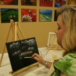 Dee Dee Scott works on what will become a palm-tree scene.