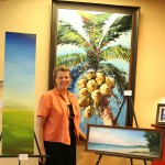 Melody LaPierre surrounds herself with art from her son Jesse (left), her daughter Sarah (right) and her late husband Joseph (in back).