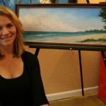 Sarah LaPierre shows off her painting, 'Little Boat Park.'